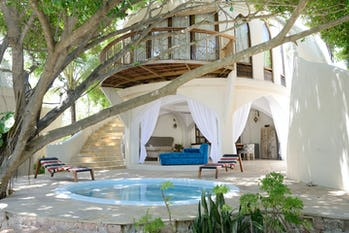 Beyond mnemba island tanzania timbuktu travel for Xanadu villas zanzibar